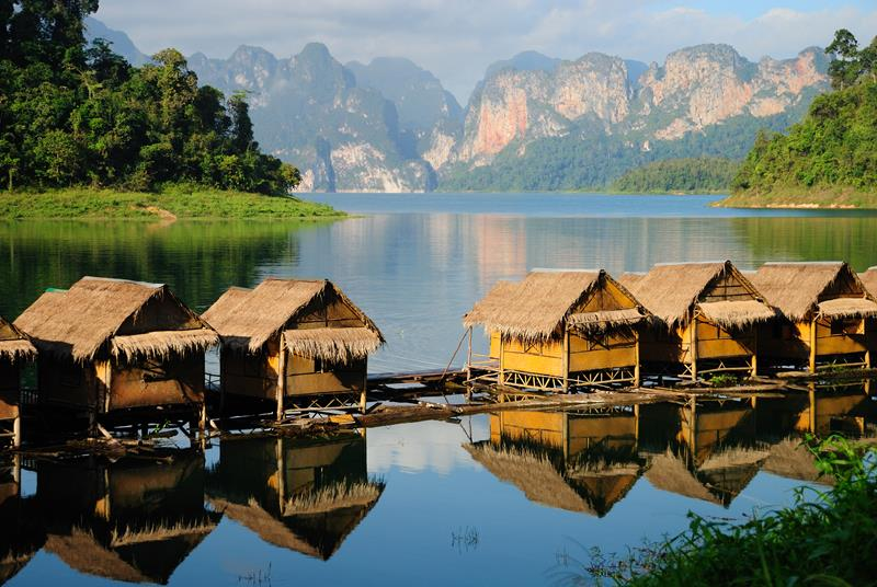 Lake with traditional huts in Thailand
