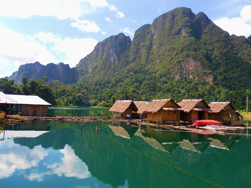 Lake with traditional huts filming location in Thailand